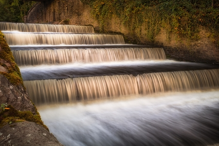 The spillway on the Lower Lliedi reservoir in Swiss Valley, Llanelli, South Wales UK