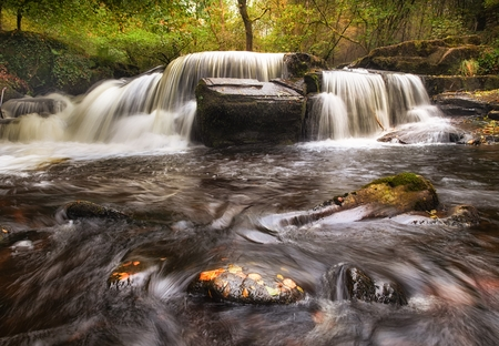brecon beacons: Autumn at Pont Cwmyfedwen falls in the beautiful Taf Fechan Forest, part of the Brecon Beacons National Park, South Wales, UK Stock Photo
