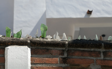 Security wall glass shards A wall covered in glass shards to deter anyone wanting to climb over