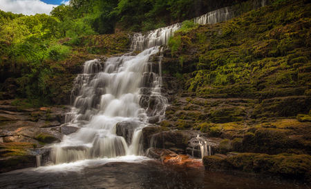The top section of Sgwd Clun Gwyn waterfall from the west bank, on the Mellte river, near Pontneddfechan in South Wales, UK.