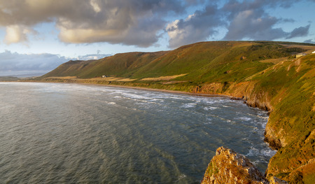 The coast of Rhossili Down on the Gower peninsula in Swansea, South Wales, voted one of the top ten beaches in the UK
