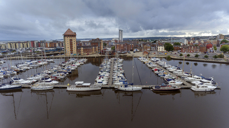 SWANSEA, UK - AUGUST 12, 2018: An aerial view of the yachts on the river Tawe and the marina area of Swansea, South Wales, UK