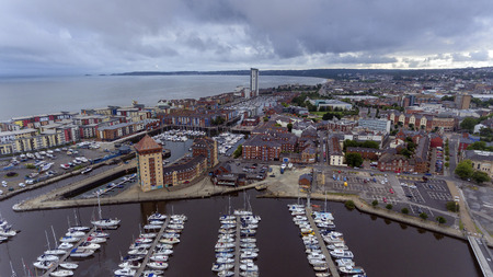 SWANSEA, UK - AUGUST 12, 2018: An aerial view of the new coastal housing and the Meridian Tower at the marina area of Swansea Bay, South Wales, UK