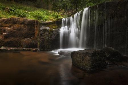 A waterfall at Blaen y Glyn. One of a series of closely connected waterfalls at Blaen y Glyn, near Merthyr Tydfil in the South Wales valleys, UK