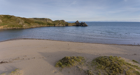 The beach at the dramatic Three Cliffs Bay on the Gower peninsula, Swansea, South Wales, UK