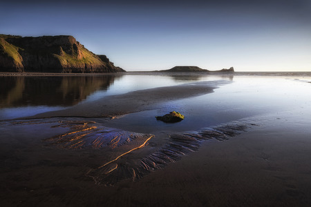 Blue hour at Worms Head on the Gower peninsula in Swansea, South Wales, UK Stock fotó