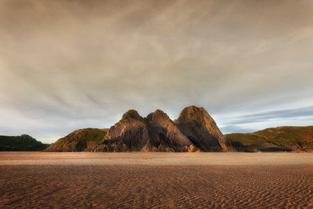 Sunset at Three Cliffs Bay on the Gower peninsula, Swansea, South Wales, UK