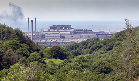 Editorial Port Talbot, UK - July 02, 2018: Port Talbot Steel Works prior to a merger between Tata Steel and Thyssenkrupp which will create Europes second-biggest steelmaker.