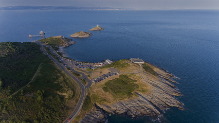 Editorial Swansea, UK - July 13, 2018: The landmarks of Mumbles, the Lighthouse, Bracelet Bay, Limeslade Bay and Tut Hill coastguard station on the Gower peninsula in Swansea, South Wales, UK. Sajtókép