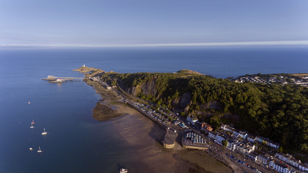 Editorial Swansea, UK - July 22, 2018: Aerial view of the Mumbles in Swansea, featuring the slipway, knab rock, the pier and lighthouse