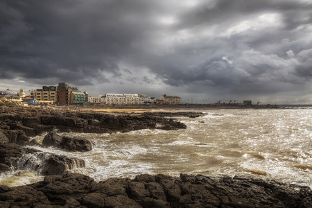 Editorial Porthcawl, UK - April 25, 2019: Strong winds and clouds form as storm Hannah starts to affect the town of Porthcawl, South Wales UK