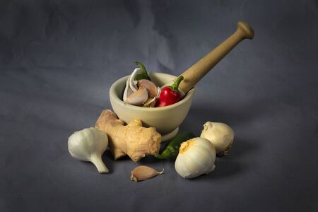 A pestle and mortar with typical basic ingredients for Asian cooking Stock fotó