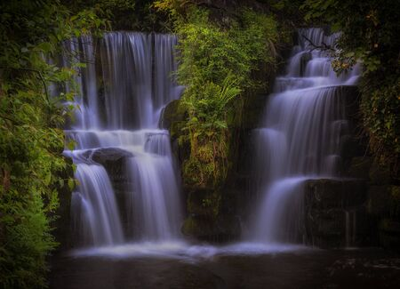 The waterfall at Penllergare Valley Woods on the Afon Llan river, easily accessible just off junction 47 of the M4 motorway in Swansea, UK. Stock fotó