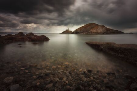Dramatic storm clouds over Swansea Bay and Mumbles lighthouse in Swansea, South Wales UK Stock fotó