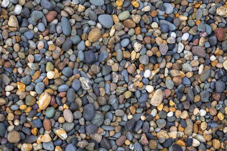 Pebbles on the North beach at Aberystwyth on Cardigan Bay, Wales, UK. Фото со стока