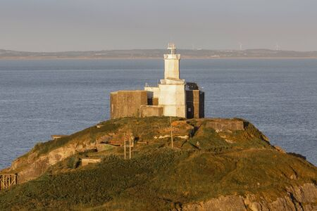 Mumbles Lighthouse The iconic landmark that is Mumbles Lighthouse on the Gower peninsula in Swansea, South Wales, UK.