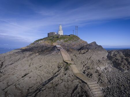 The steps that lead to Mumbles Lighthouse and world war two battlements in Swansea, South Wales UK Фото со стока