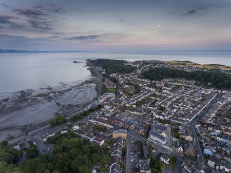 Dusk over Mumbles village, a tourist location in South Wales, UK, overlooking Swansea Bay on the east side of the Gower Peninsula.
