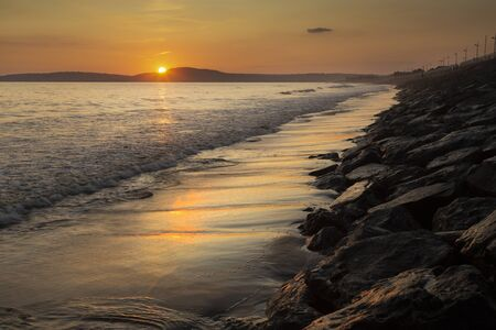 Sunset at Aberavon beach in Port Talbot, South Wales, UK Фото со стока