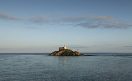 Mumbles Lighthouse island The iconic landmark that is Mumbles Lighthouse on the Gower peninsula in Swansea, South Wales, UK.