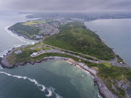 Editorial Swansea, UK - June 17, 2019: Mumbles Hill nature reserve and Award winning Bracelet Bay near Mumbles Lighthouse on the Gower peninsula in Swansea, South Wales, UK