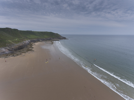 Editorial Swansea, UK - June 24, 2019: Caswell Bay on the South Gower peninsula, Swansea, the most commercial and popular beach close to the city. Редакционное