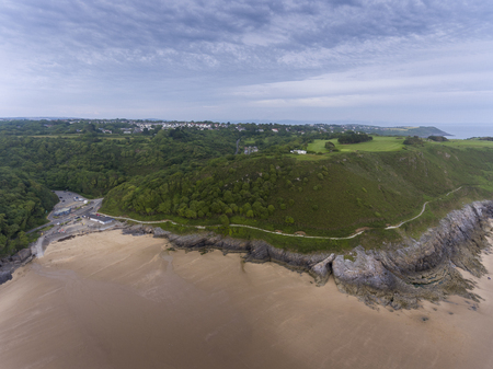 Editorial Swansea, UK - June 24, 2019: Caswell Bay shops and car park on the South Gower peninsula, Swansea, the most commercial and popular beach close to the city.