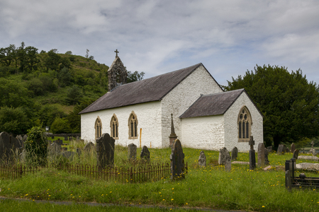 Editorial Aberystwyth, UK - July 08, 2019: St Michaels church in Talley village, Carmarthen, Mid Wales, UK, next to the ruins of Talley Abbey
