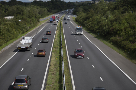 Editorial Swansea, UK - August 12, 2019: Free flowing traffic on the M4 motorway at junction 47 in South Wales, UK. Редакционное