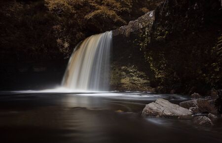 The waterfall known as Lady Falls or Sgwd Gwladus after prolonged rainfall on the river Afon Pyrddin near Pontneddfechan, South Wales, known as Waterfall Country Imagens