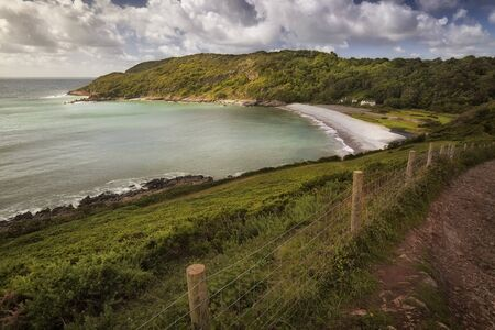 The Wales coastal path at Pwll Du bay on the Gower peninsula, Swansea, a long-distance footpath which runs along the whole of the coastline of Wales.