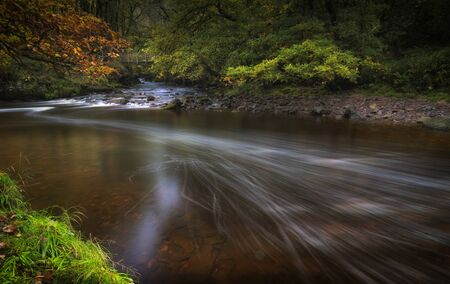Long exposure of the Afon Pyrddin River on the way to Sgwd Gwladus waterfall in South Wales, UK Imagens