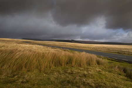 Incoming storm clouds Changeable weather on the A4059 from the village of Penderyn heading towards Penyfan in the Brecon Beacons, South Wales UK