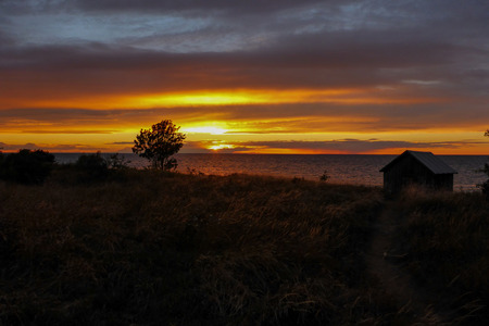 horizontals: Sunset over the Baltic Sea at the Northern Island Oland Sweden