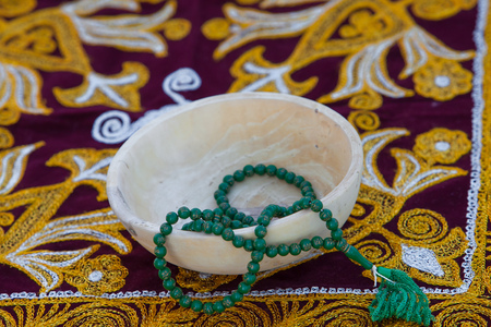 submission: wooden bowl, beads, green