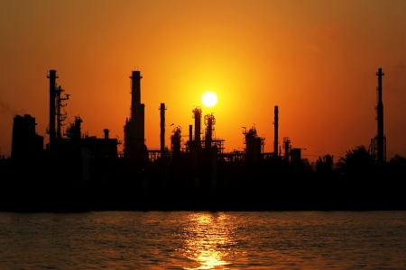 The silhouette of oil refinery at sunrise in Bangkok, Thailand