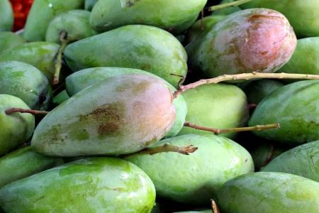 Pile of mango on market tray Stock Photo