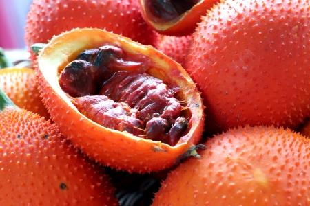 Gac fruit at fruit market  Stock Photo