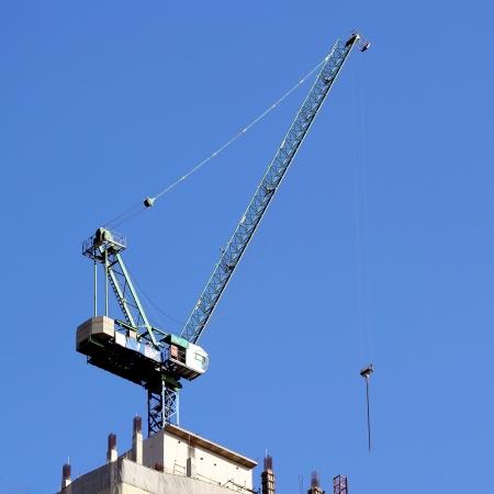 Working crane against blue sky