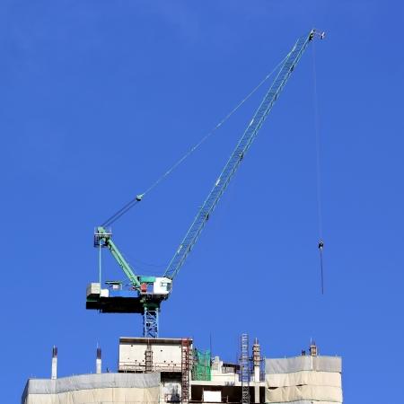 Working crane on construction site Stock Photo