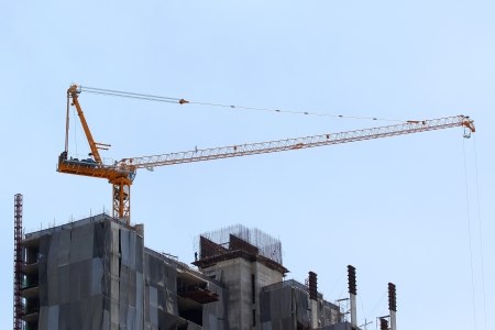 Construction site with crane on sky background