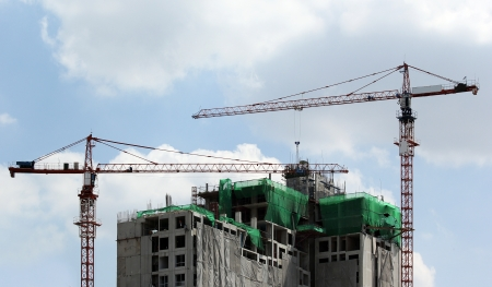 Working crane against beautiful sky