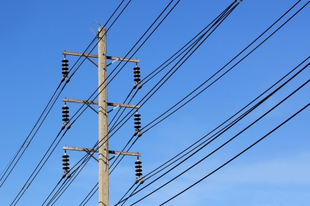 High voltage electric pole on sky background photo