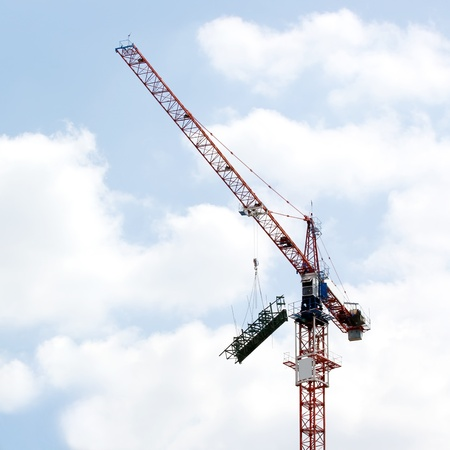 Working crane against beautiful sky photo