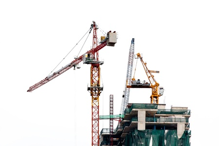 Construction site with crane on white background