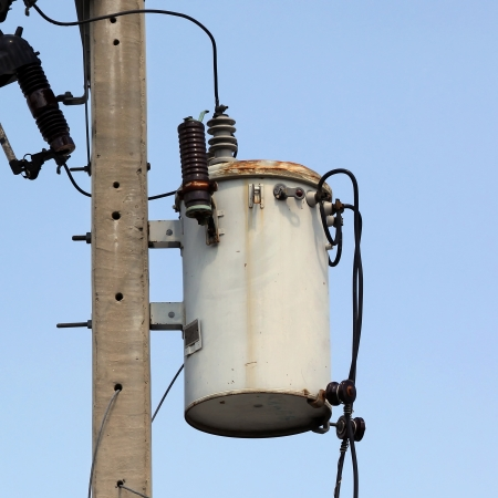 Old transformer on electric pole photo