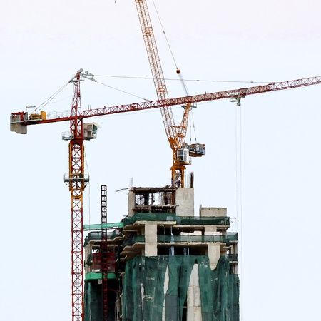 Tower crane and building under construction  photo