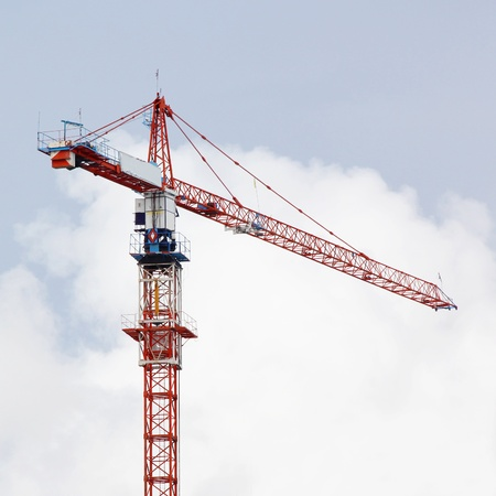 Working crane on sky background photo