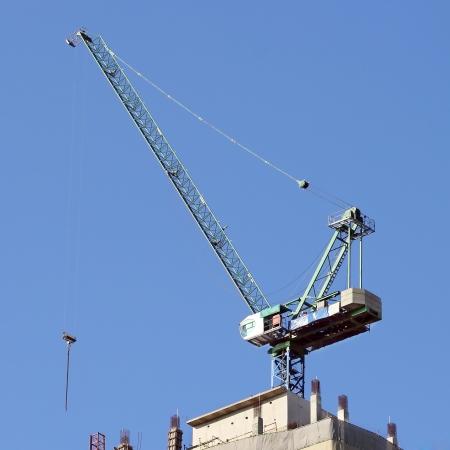Working crane against blue sky photo