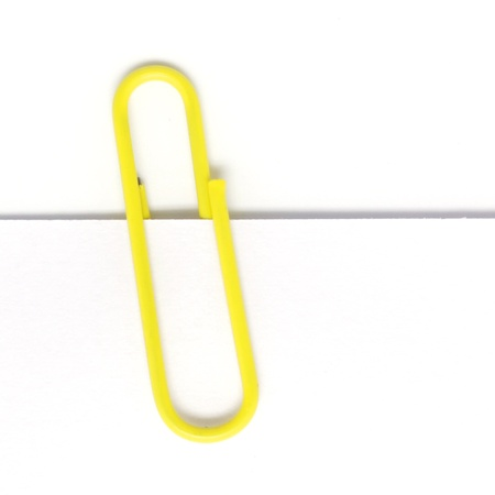 Paper clip isolated on white background photo